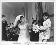 thumbnail link to original 1967 US b&w still The Graduate Ben seizing Elaine at wedding
