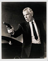 thumbnail link to original U.S. still Lee Marvin Point Blank, holding gun, as used in 1-sheet poster.