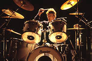 thumbnail link to photograph Rick Buckler on drums