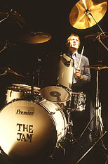 thumbnail link to photograph Rick Buckler at drum kit