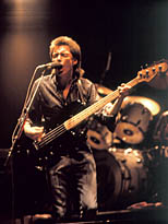 thumbnail link to photograph Bruce Foxton playing bass and singing on stage