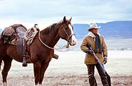 thumbnail link to photograph of Steve outdoors with horse and rifle as Tom Horn