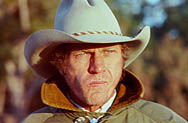 thumbnail link to photograph of Steve on location as Tom Horn, looking into the sun