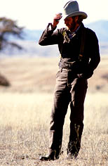 thumbnail link to photograph of Steve as Tom Horn on location, tipping his hat