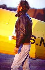 thumbnail link to photograph of Steve at dawn by plane wearing flying jacket