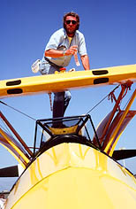 thumbnail link to photograph of Steve on top of his yellow vintage plane Santa Paula airport
